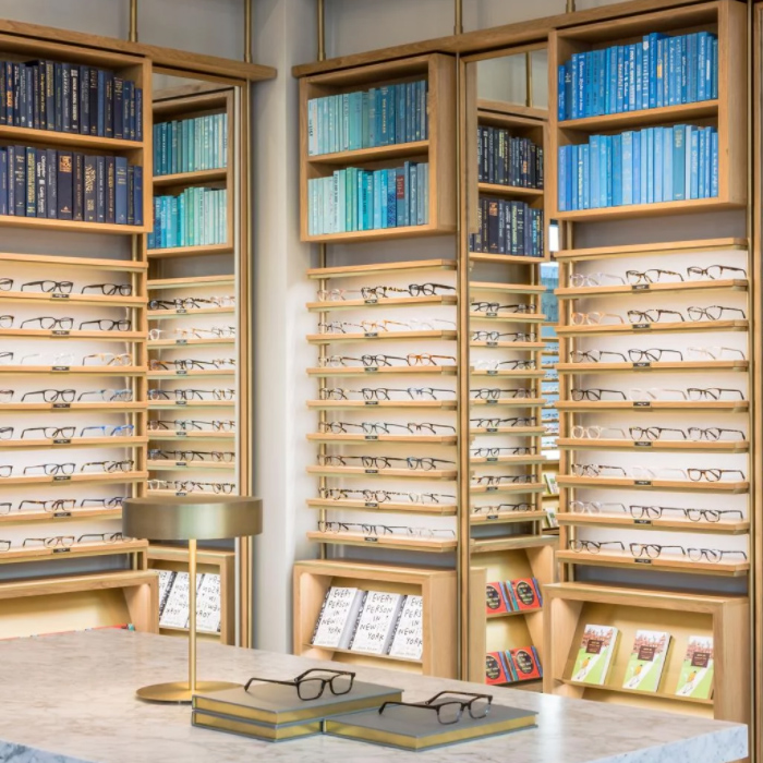 warby shelves filled with glasses and blue books